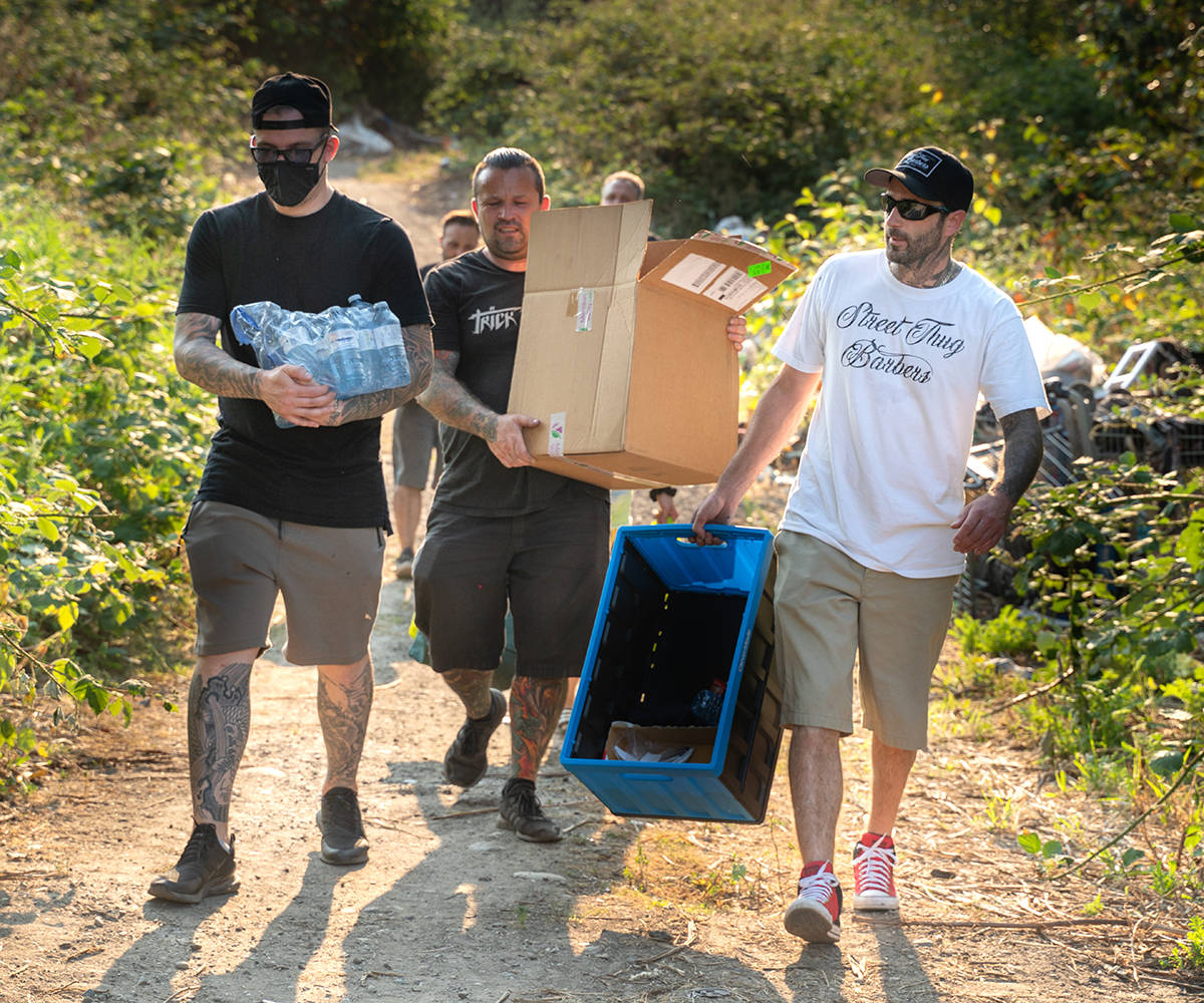 Joseph Sikora (far right) and his team of Street Thug Barbers deliver food to the homeless population in Abbotsford. (Submitted photo)