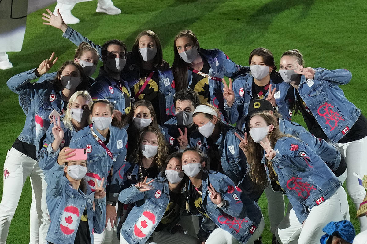 Canada athletes pose for a photo during the closing ceremony in the Olympic Stadium at the 2020 Summer Olympics, Sunday, Aug. 8, 2021, in Tokyo, Japan. (AP Photo/Lee Jin-man)