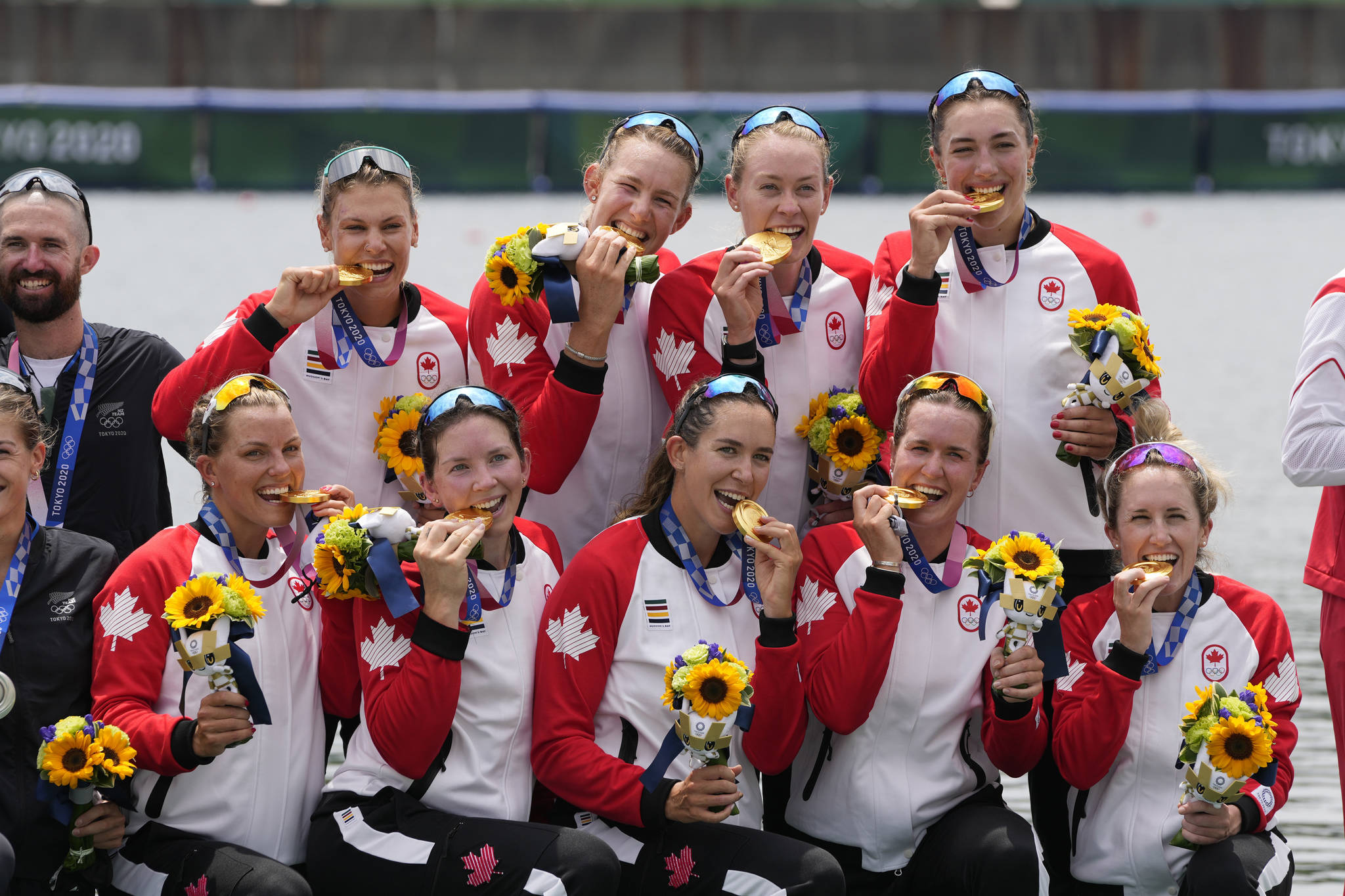 Gold medalists Lisa Roman, Kasia Gruchalla-Wesierski, Christine Roper, Andrea Proske, Susanne Grainger, Madison Mailey, Sydney Payne, Avalon Wasteneys and Kristen Kit of Canada pose during the medal ceremony for the women's rowing eight final lat the 2020 Summer Olympics, Friday, July 30, 2021, in Tokyo, Japan. (AP Photo/Lee Jin-man)