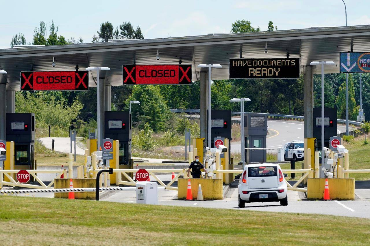 FILE - In this June 8, 2021, file photo, a car approaches one of the few lanes open at the Peace Arch border crossing into the U.S. in Blaine, Wash. Canada is lifting its prohibition Monday, Aug. 9 on Americans crossing the border to shop, vacation or visit, but the United States is keeping similar restrictions in place for Canadians. The reopening is part of a bumpy return to normalcy from COVID-19 travel bans. (AP Photo/Elaine Thompson, File)