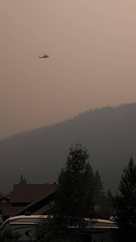 A helicopter is shown near the White Rock Lake wildfire near Westwold, B.C., in this recent handout photo. THE CANADIAN PRESS/HO - Brenda Geisbrecht