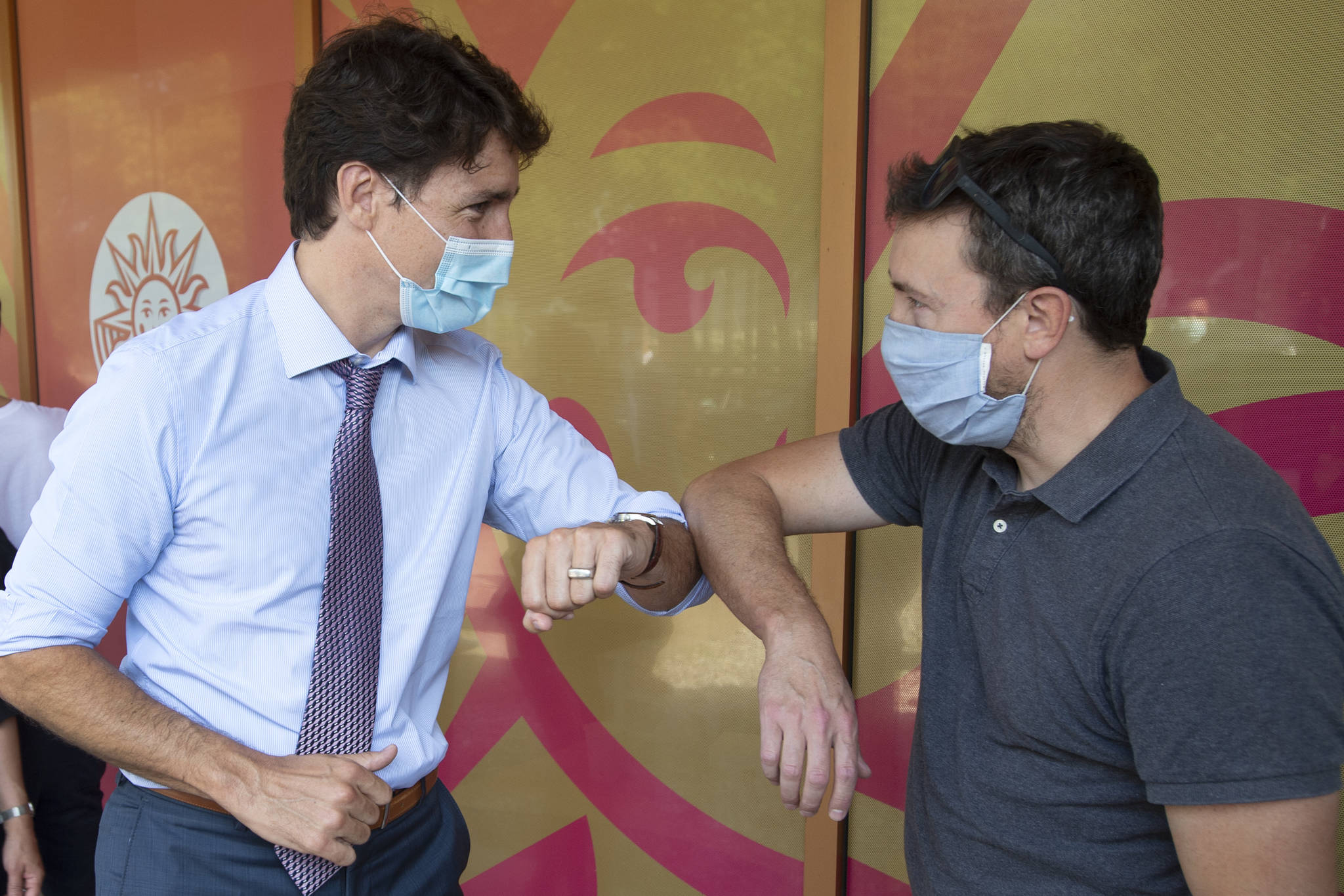Prime Minister Justin Trudeau greets people waiting for their shots while visiting a COVID-19 vaccination clinic Thursday, July 15, 2021 in Montreal.THE CANADIAN PRESS/Ryan Remiorz