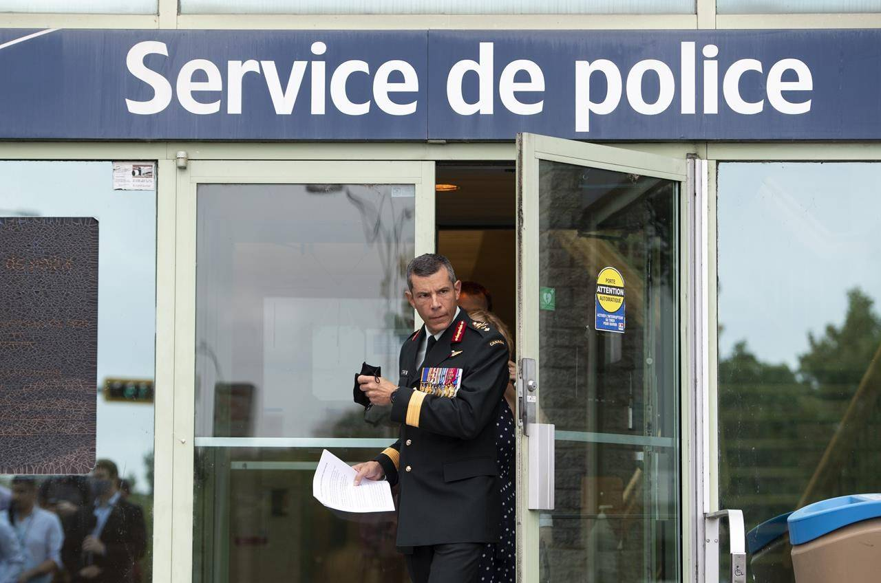 Maj.-Gen. Dany Fortin leaves the Gatineau Police Station after being processed, in Gatineau, Que., on Wednesday, Aug. 18, 2021. THE CANADIAN PRESS/Justin Tang