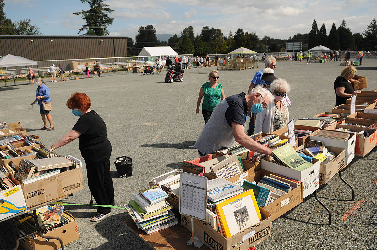 People check out the items for sale during the Chilliwack Rotary One-Day Book Sale on Saturday, Aug. 29, 2020. (Jenna Hauck/ Chilliwack Progress file)