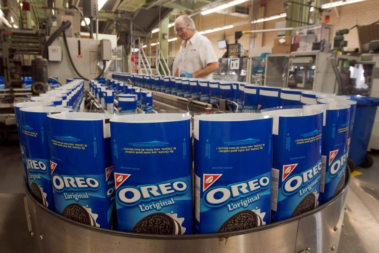 A worker keeps an eye on the Oreo cookie production line at the plant that makes all the Oreos for Canada, Wednesday, February 29, 2012 in Montreal. THE CANADIAN PRESS/Ryan Remiorz
