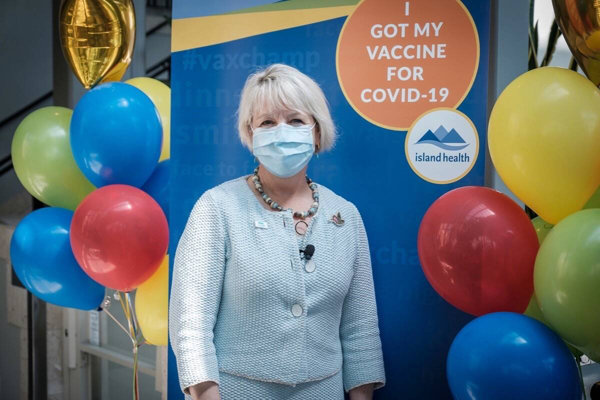 B.C. provincial health officer Dr. Bonnie Henry visits COVID-19 vaccination clinic in Victoria as the province shifts to drop-in availability to increase community immunity, Aug. 3, 2021. (B.C. government photo)
