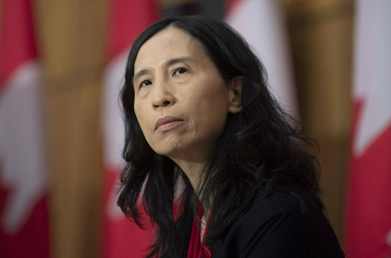 Chief Public Health Officer Theresa Tam listens to a question during a news conference, in Ottawa, Tuesday, Dec. 1, 2020. Canada's chief public health officer says there is an urgent need for more people between 18 and 39 to get vaccinated against COVID-19 to reduce the impact of the Delta variant. THE CANADIAN PRESS/Adrian Wyld
