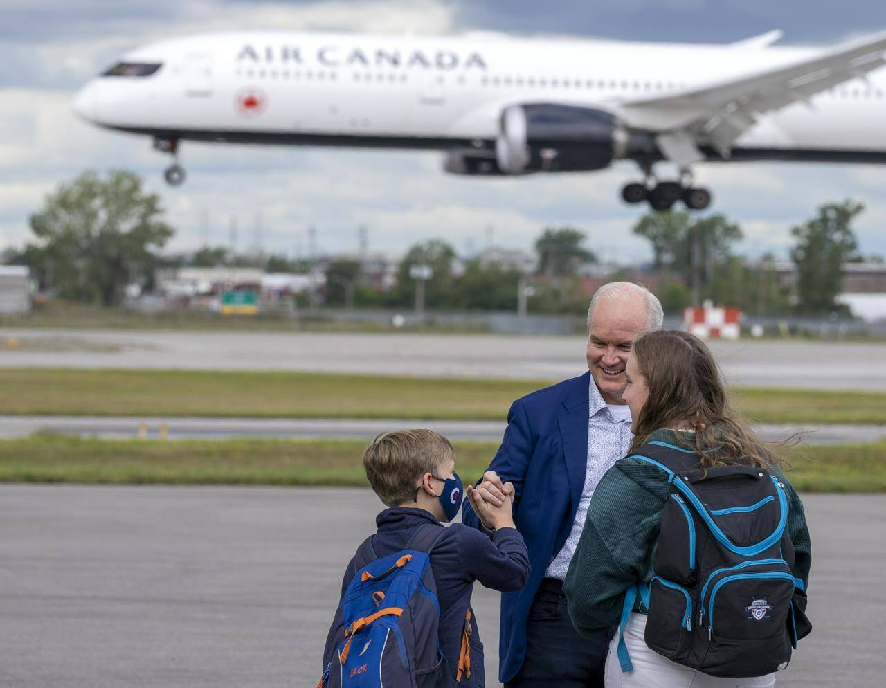 Conservative Leader Erin O'Toole greets his children Jack and Mollie on the tarmac in Montreal on Friday, September 3, 2021. Canadians will vote in a federal election Sept. 20th. THE CANADIAN PRESS/Frank Gunn