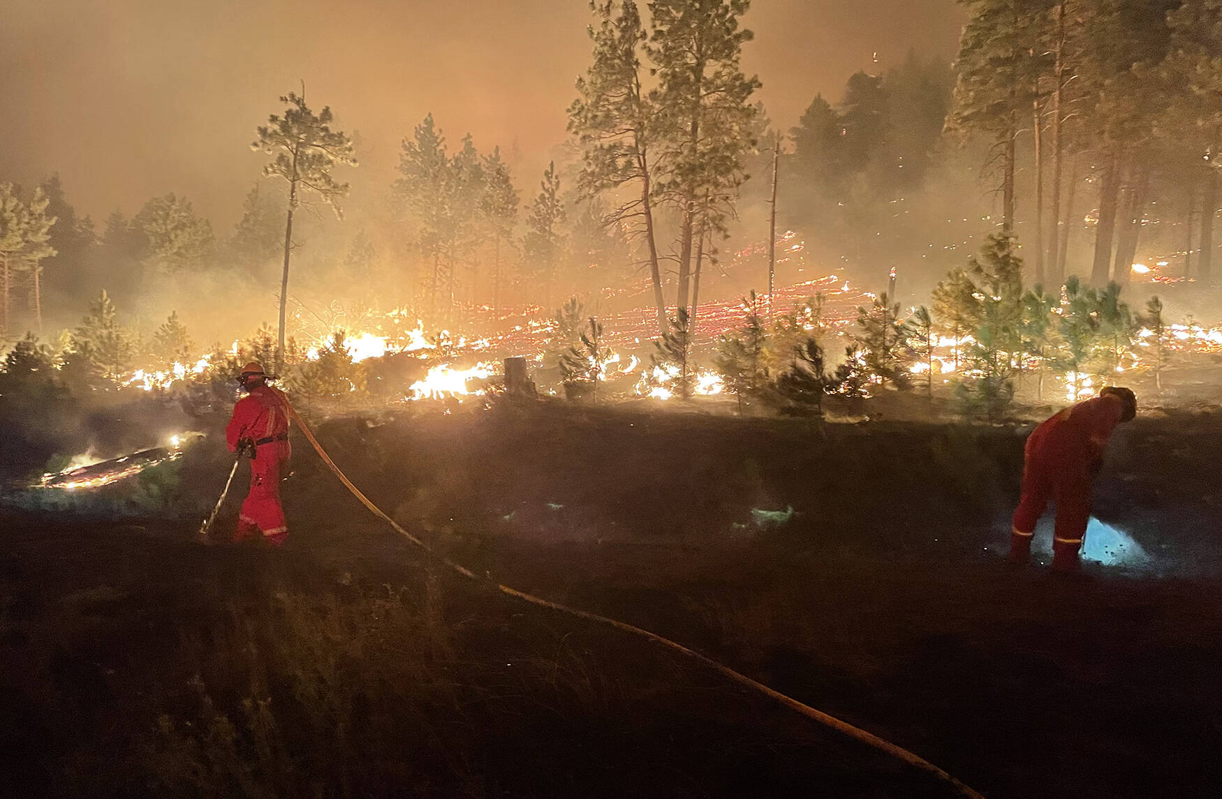 Chilliwack River Valley volunteer firefighters on the ground fighting one of the many wildfires that blazed through B.C. this summer. (Submitted photo)