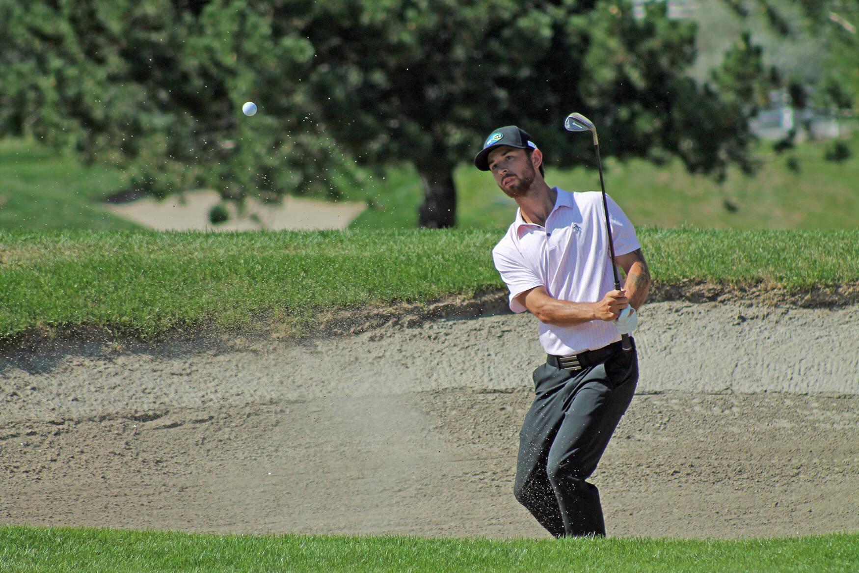 Chilliwack's Jake Scarrow hits out of a bunker during the PGA of BC Championship tournament, played Aug. 24 at the Rivershore Golf Links in Kamloops. (PGA of BC photo)