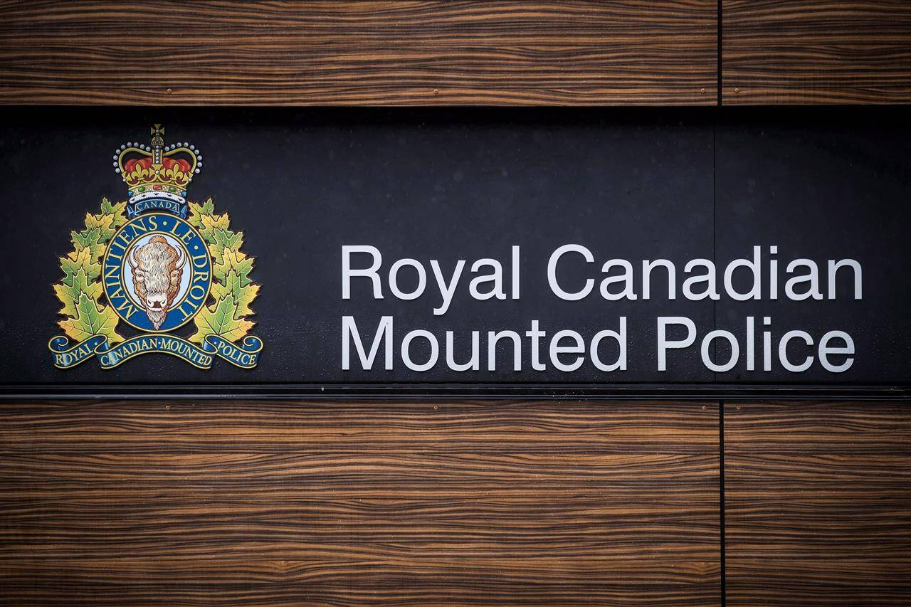 """The RCMP logo is seen outside Royal Canadian Mounted Police """"E"""" Division Headquarters, in Surrey, B.C., Friday, April 13, 2018. RCMP say a woman and her 16-month-old toddler found dead in Hinton, Alta., were killed in the apartment of the suspect charged in their deaths. THE CANADIAN PRESS/Darryl Dyck"""