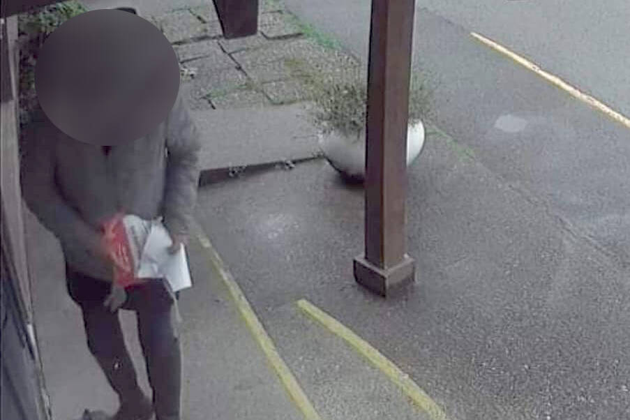 A would-be customer of the Harrison Corner Cafe can be seen on security footage allegedly destroying signage after a confrontation with staff over COVID-19 vaccine passports a few days before. (Screenshot/Leanne Bourgoin-Faessler)