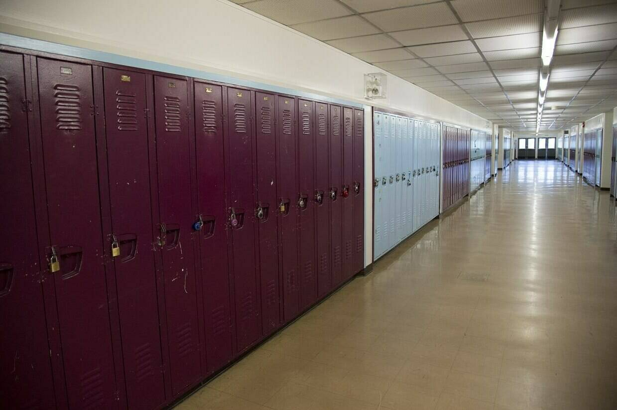 An empty hallway is pictured at a school in Vancouver, B.C. Monday, March 23, 2020. THE CANADIAN PRESS/Jonathan Hayward