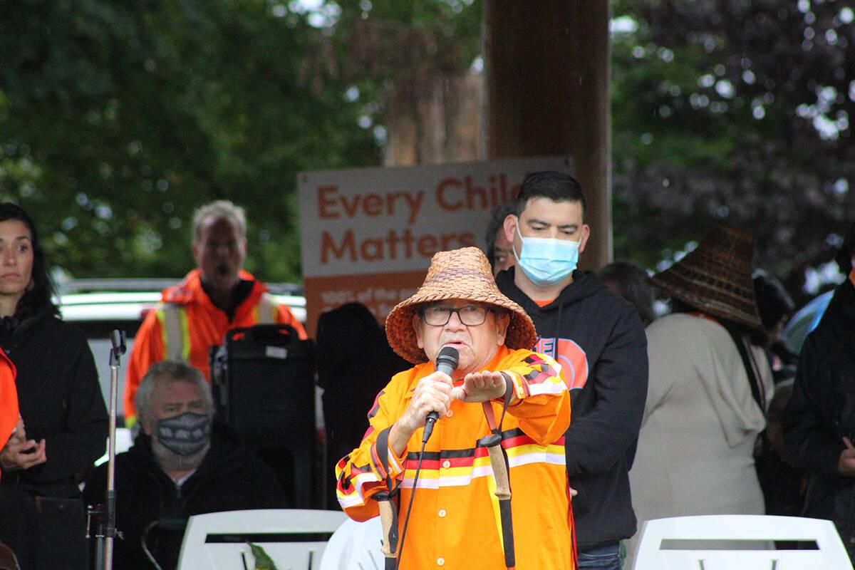 Elder Lekeyten of Kwantlen First Nation speaks to the crowd shortly before singing. Patrick Penner photo.