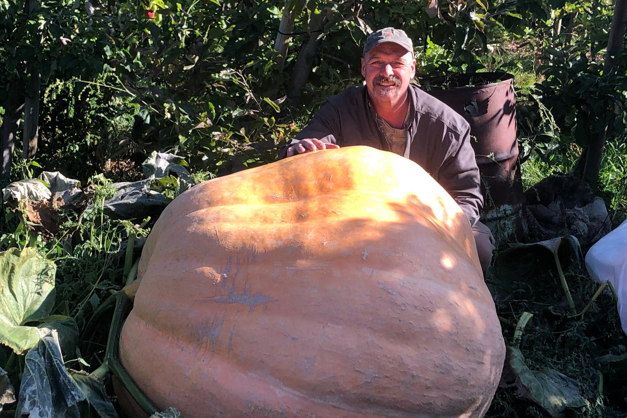 Billy Boerboom shows a massive pumpkin grown at his farm in Summerland. (Black Press file photo)