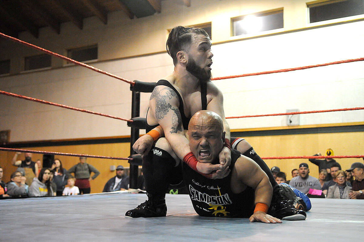 """Rob the Giant (4'11"""") gets a hold on Short Sleeve Sampson during a Midget Wrestling Warriors event at Tzeachten Hall in Chilliwack on March 22, 2019. Tuesday, Oct. 5 is Kiss a Wrestler Day. (Jenna Hauck/ Chilliwack Progress file)"""
