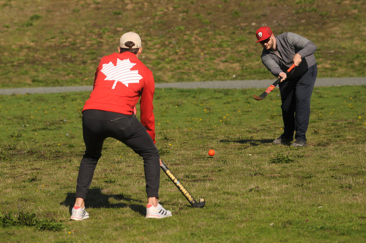 Kiefer McNaughton (right) shoots the ball to Olympic athlete Oliver Scholfield during a visit to Chilliwack at Watson Glen Park on Friday, Oct. 1, 2021. (Jenna Hauck/ Chilliwack Progress)