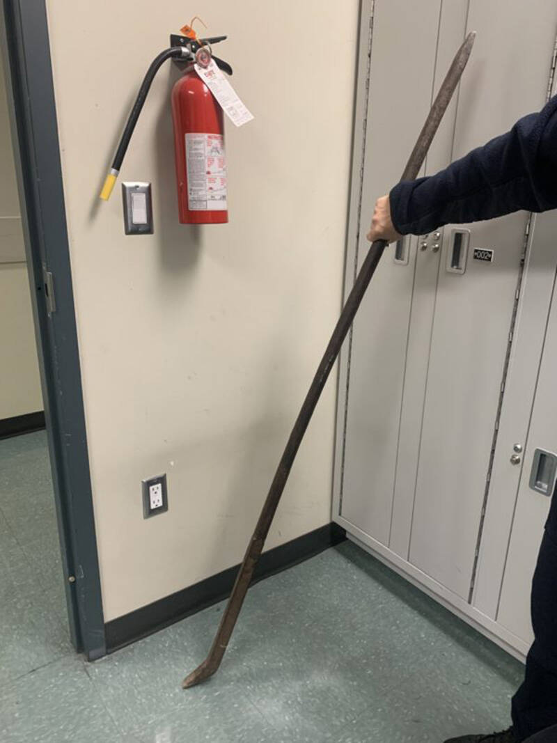 Police found a 'long metal pointed rod' next to the neighbour's door on Friday, Oct. 1, 2021. (New Westminster Police))
