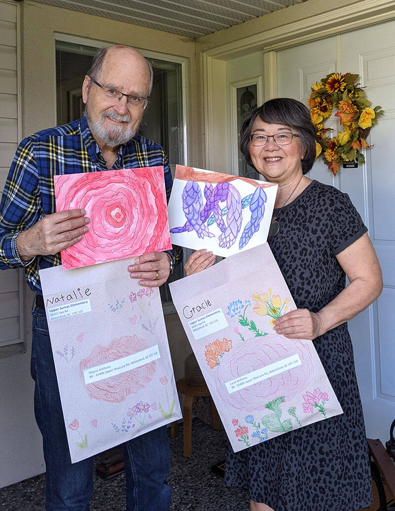 Wayne and Carol Anthony display the watercolour paintings they received from students at Upper Sumas Elementary as part of the Planting Intergenerational Promises project. (Submitted photo)