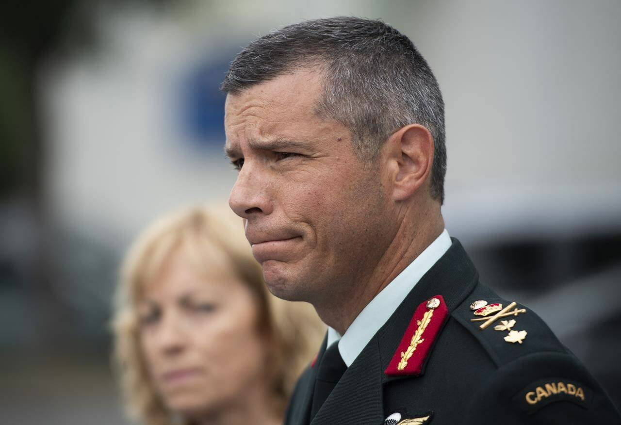 Maj.-Gen. Dany Fortin speaks to reporters outside the Gatineau Police Station after being processed, in Gatineau, Que., on August 18, 2021. THE CANADIAN PRESS/Justin Tang