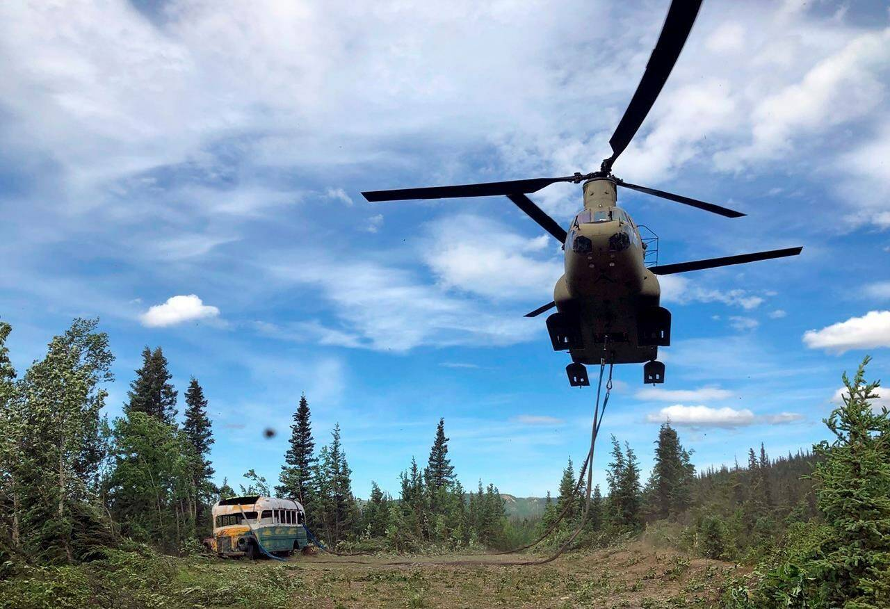 """FILE - In this June 18, 2020, file photo released by the Alaska National Guard, Alaska Army National Guard soldiers use a CH-47 Chinook helicopter to removed an abandoned bus, popularized by the book and movie """"Into the Wild,"""" out of its location in the Alaska backcountry as part of a training mission. The bus that once lured people on sometimes deadly pilgrimages to Alaska's backcountry can now safely be viewed at the University of Alaska Fairbanks while it undergoes preservation work. The bus was moved to the University's Engineering facility in early Oct. 2021, while it's being prepared for outdoor display at the Museum of the North, Fairbanks television station KTVF reported. (Sgt. Seth LaCount/Alaska National Guard via AP, File)"""