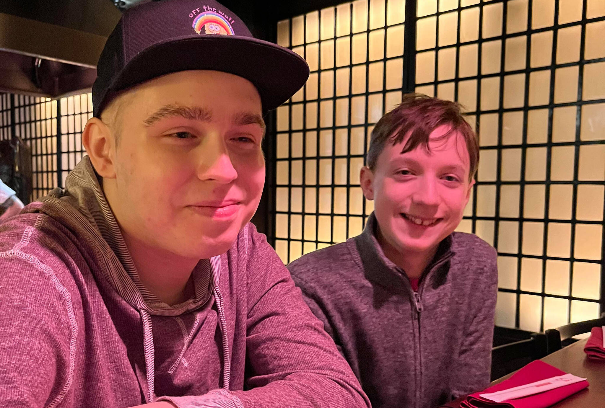 To celebrate finishing his first round of chemotherapy, Addison Johnston (left) and his younger brother Ryland were taken to a Japanese restaurant in Vancouver by parents Kristin and Shane Johnston. But lots of treatment remains for the teenager, and his family has learned some hard lessons about the healthcare system. (submitted photo)