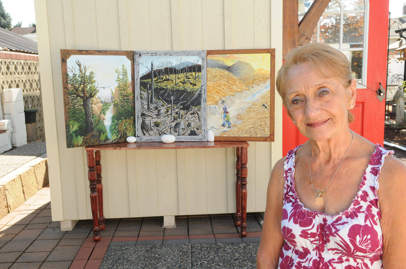 Mignonne Shields' three climate change painting entitled (from left) Yesterday, Today and Tomorrow were inspired by a conversation she had with Canadian painter Robert Bateman. (Jenna Hauck/ Chilliwack Progress)